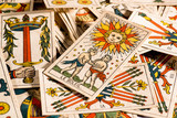 Vintage tarot cards lying disorderly
