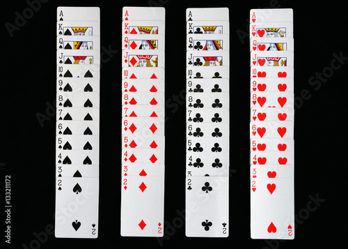 Poster playing cards spread out on a black background