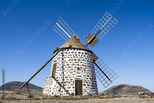 Poster A four wing round male windmill on the Canary Islands Fuertevent
