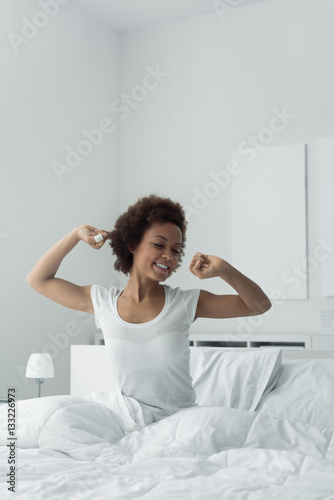Plagát Woman waking up and stretching
