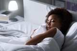 Woman sleeping in he...