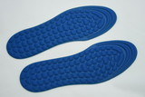 blue Orthopedic insoles for athletic shoes on white background