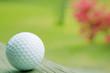 Plaing golf. Golfer finishing his driver swing. Golf ball