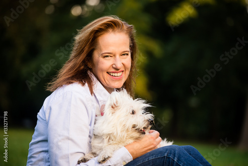 Poster Senior woman with dog