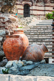 Ancient amphoras near Ruined Church of Christ Pantocrator in Nesebar. Bulgaria