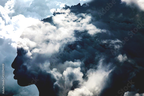 Double exposure of girl profile portrait and stormy cloudscape - 133294909