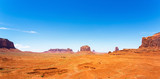 Sandstone mountains in desert of Monument Valley