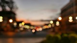 Defocused traffic and city lights on urban big street at dusk.