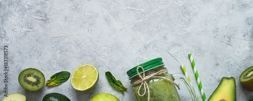 Healthy green food background - smoothie and ingredients. Long banner format for web.