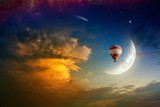 Dream concept - hot air balloon in glowing sky with rising moon - 133327962