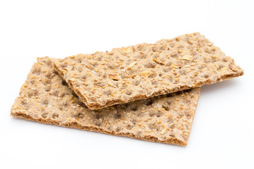 Stack of wholegrain crispy bread with sunflower, chia and sesame