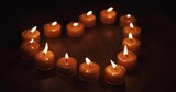 tealight candles in a shape of a heart in slow motion, 4k 60fps prores footage