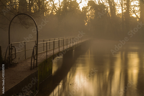 Poster Footbrige at twilight with mist.