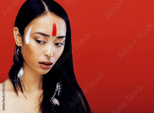 Poster beauty young asian girl with make up like Pocahontas, red indian