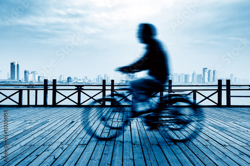 Poster Man riding a bicycle on the floor