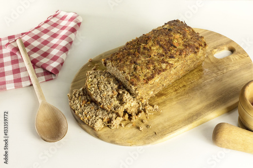 Poster Freshly cooked and cut meatloaf on wooden board