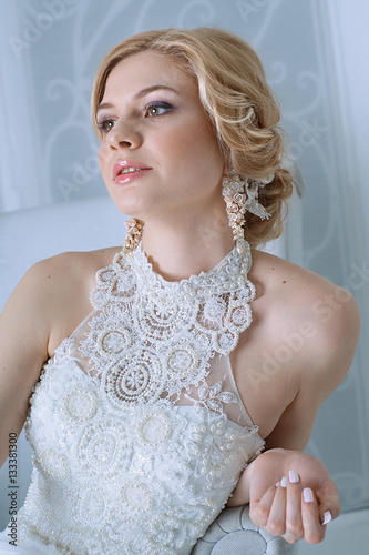 Poster beautiful young woman in a white dress