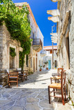 Authentic traditional Greece - cute street tavernas, Naxos island - 133392978