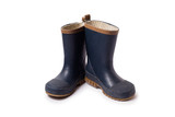 Blue worn gumboots on white background - 133393348