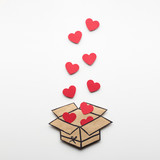 Full of love / Creative valentines concept photo of a box full of hearts on white background.