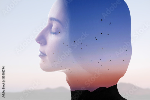 Poster Double exposure photo with woman silhouette and sunset sky with mountains and birds