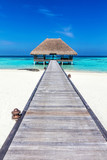 Wooden jetty leading to relaxation lodge. Maldives islands - 133419355