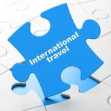 Travel concept: International Travel on puzzle background