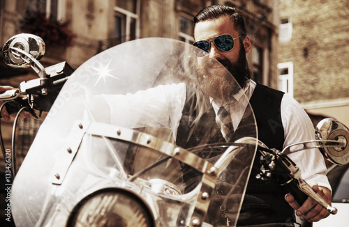 Poster Serious Bearded Biker Man Sitting on a Motorcycle