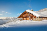 Wooden mountain chalet in the alps in winter - 133436107