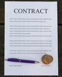 Pen and stamp on a filled contract