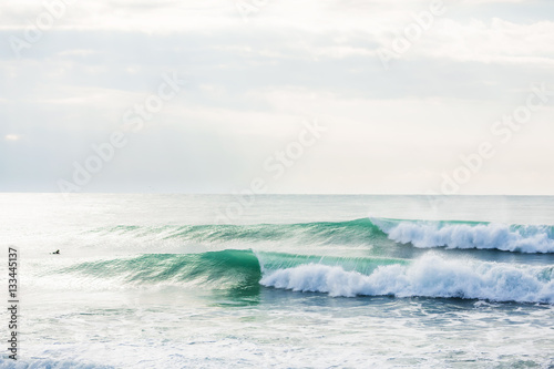 Green waves in ocean. Sunny day - 133445137