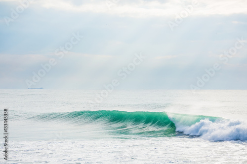 Clear wave in ocean. Sunny day - 133445358