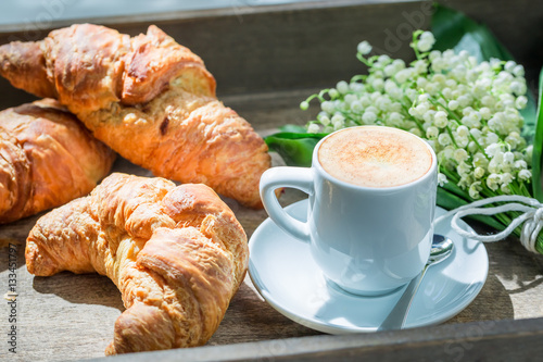 Poster Hot coffee and delicious croissant for breakfast