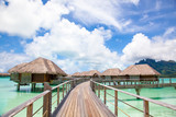 Bora Bora.  Bridge to over water bungalow.  Paradise in Bora Bora - 133456926