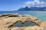 Rio de Janeiro, Ipanema beach, Gavea stone and Two Brothers hill seen through the Arpoador stones