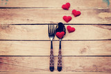 Table setting cutlery and red heart for dinner Valentine Day.