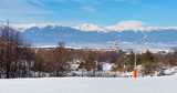 Winter ski resort Bansko, ski slope and mountains view