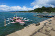 Pink Fishing Boat Docked in Local Village