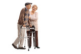 Mature woman helping a mature man with a walker
