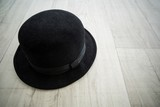 Black bowler hat in dance studio
