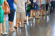 Closeup Queue of Asian people waiting at boarding gate at airport - 133532912