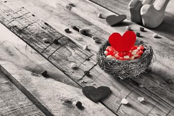 Selective focus image of red heart in the nest