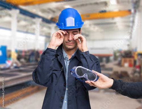Worker having a splinter in his eye