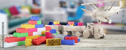 Plastic building blocks,plane and blur background
