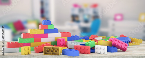 Plastic building blocks and blur background