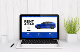 laptop on table rent a car