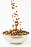 Pet food falls into the bowl for feeding - 133548934