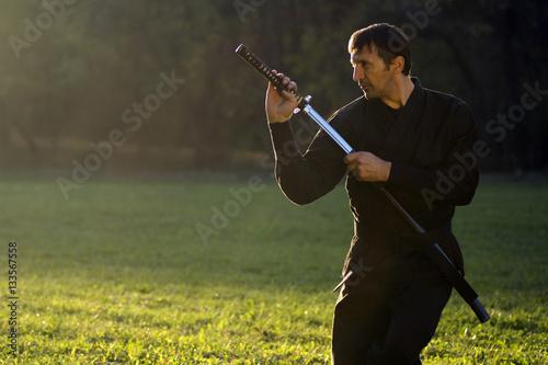 Poster black ninja with sword