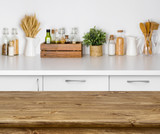 Fototapety Brown wooden table with bokeh image of kitchen bench interior
