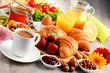 Quadro Breakfast consisting of croissants, coffee, fruits, orange juice